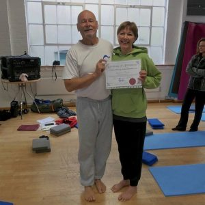 Kate Davies receiving her Stretch Therapy certificate from Kit Laughlin
